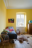 A children's room painted yellow in an apartment in a period building