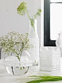 Glass vases and bottles decorated with lace trim