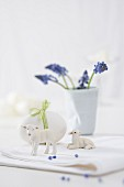 Decorative Easter lamb figurines, an egg and grape hyacinths