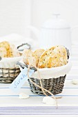 A bread basket with a name tag on a striped table runner