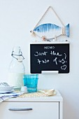A maritime memo board on a kitchen wall