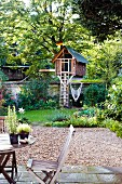 Garden with terrace & small tree house