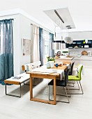 Dining room with wooden table and chairs and bench with leather upholstery