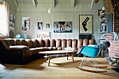 Country-house living room with wood-panelled walls & large, curving sofa