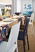 Set dining table and chairs of various colours