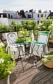 Garden chairs with loose covers and table on roof terrace