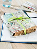 A travel diary covered with a map