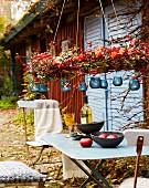 Garden table decorated with autumnal wreath & tealight lanterns