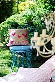A cushion on a blue garden chair