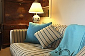 Decorative cushions on a sofa with a striped cover