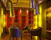 Men's den illuminated in yellow light and several chrome extractor hoods