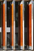 Revolving wooden shutter in metal frames