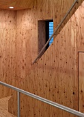 Stairwell and stairs with wood paneling
