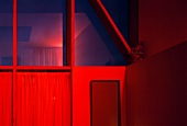 Corner of room bathed in red light