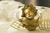 A cherub and ribbon as Christmas decorations