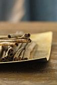 Cinnamon sticks in the golden dish