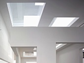Contemporary architecture with glass covered cut-outs in a ceiling