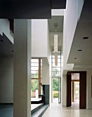 Contemporary house with open foyer and view of open terrace door