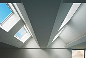 View of ceiling in top floor of contemporary building with skylights in sloping roof