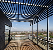 Modern roof terrace with pergola and panoramic view of city