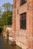 Old brick facade of an English home on the river