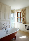 Free standing bathtub with a vintage look in a white, traditional bathroom