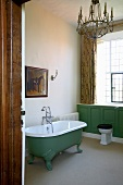 Freestanding bathtub in a vintage look in a traditional bathroom of a country castle