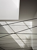Cables stretching across an area under a white ceiling