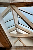 View of a modern skylight above old, rustic wooden construction