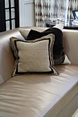 Pillows in shades of brown on a sofa upholstered in light brown material