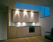 Custom made kitchen in designer style under a skylight