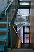 Narrow stairwell with metal stairs and banister