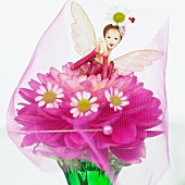 Decorative fairy on a dahlia flower