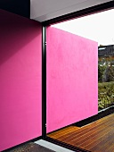 Pink wall in a living room on a terrace