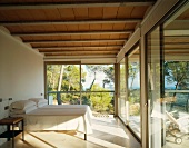 Minimalist bedroom with panoramic window