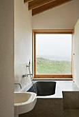 Custom made stone bathtub in a small bathroom with a fantastic view