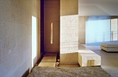 Light and shadows playing on a tiled wall and light stone bench in a minimalist living room