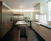 Modern hermetic kitchen with island and white counter top