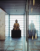Buddha statue in a minimalist lobby on slate tiles