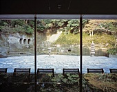 View through a glass facade of a traditional, Japanese courtyard