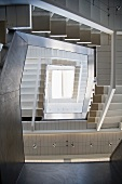 A view through a contemporary stairwell to a skylight
