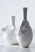 White vases decorated with flowers