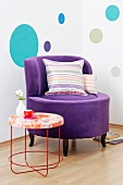 A purple Lounge chair with a velvet cover next to a Moroso table