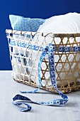 Basket with a pillow and a ribbon