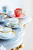 Assorted cups on a marble top table