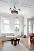 View of a living room with a stucco ceiling in an old apartment