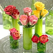 Assorted roses in vases as table decorations