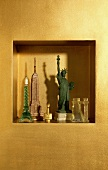 Miniature Statue of Liberty and miniature buildings in gold painted niche