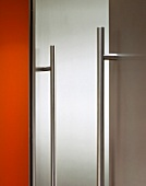 Stainless steel handle rail on cupboard door