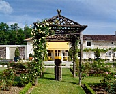 Rustic, Asian style pergola in a landscaped garden in front of a country home